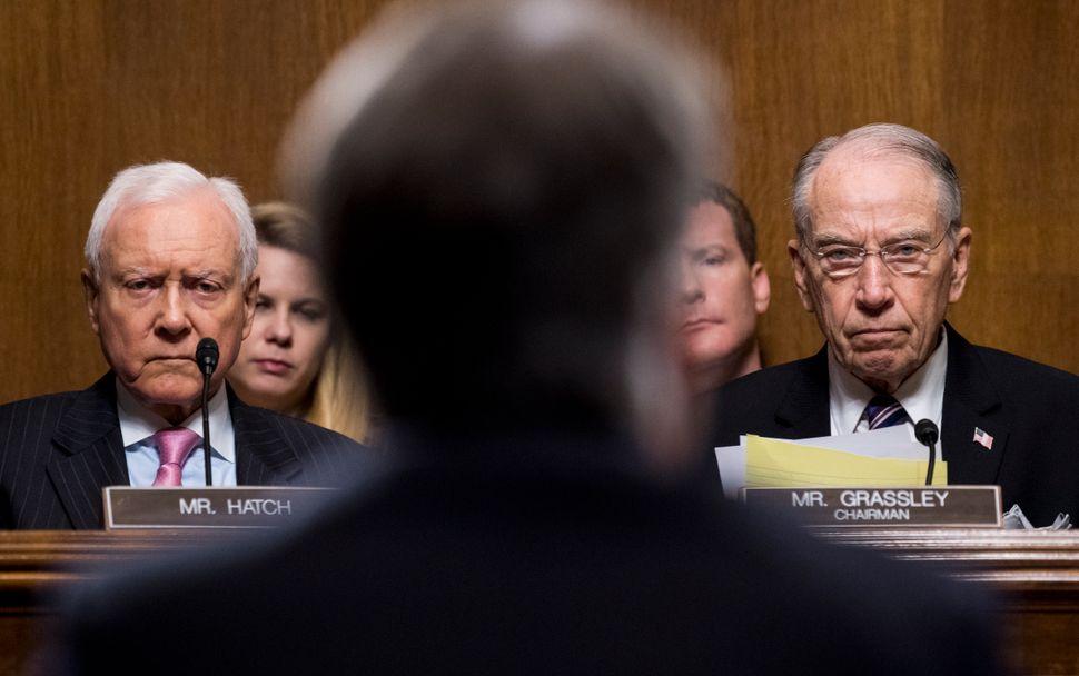 Sen. Orrin Hatch (R-Utah) and Sen. Chuck Grassley (R-Iowa) listen to Kavanaugh.