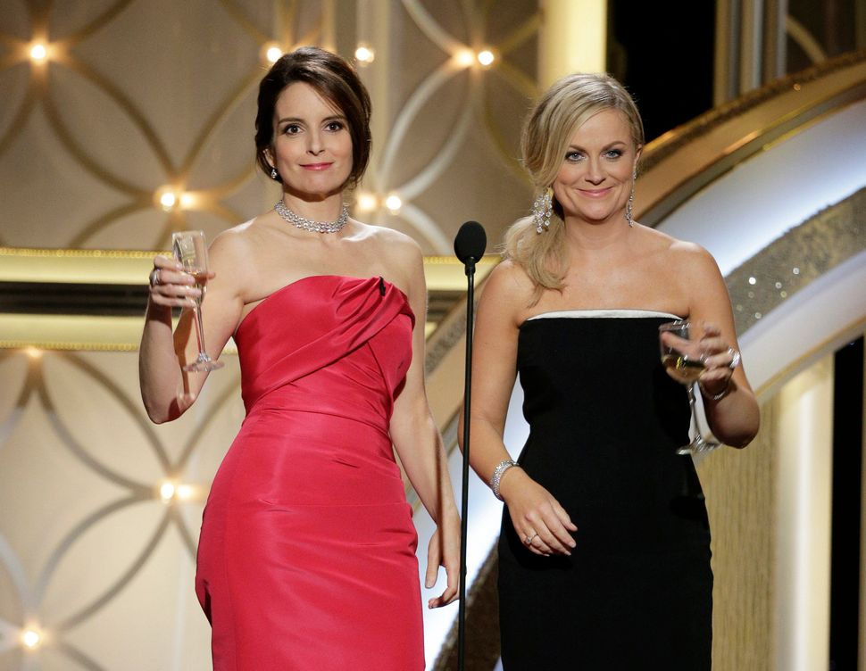 "Tina Fey and Amy Poehler <a href=""https://www.huffpost.com/entry/golden-globes-review_n_4586176?ir=Comedy"" target=""_blank"">ho"
