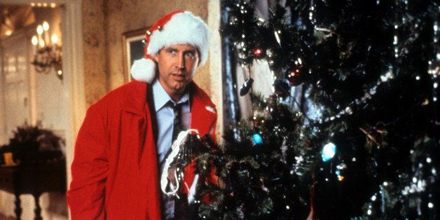 Chevy Chase hides behind the tree in a scene from the film 'Christmas Vacation', 1989. (Photo by Warner Brothers/Getty Images