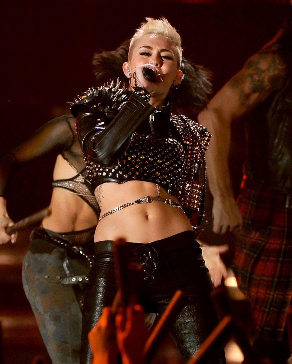LOS ANGELES, CA - DECEMBER 16:  Singer Miley Cyrus performs onstage during 'VH1 Divas' 2012 at The Shrine Auditorium on Decem