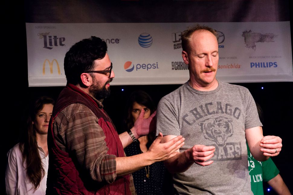 "<a href=""http://schedule.sxsw.com/2015/events/event_CE00048"" target=""_blank"">Upright Citizen Brigade Presents: ASSSSCAT</a>,"