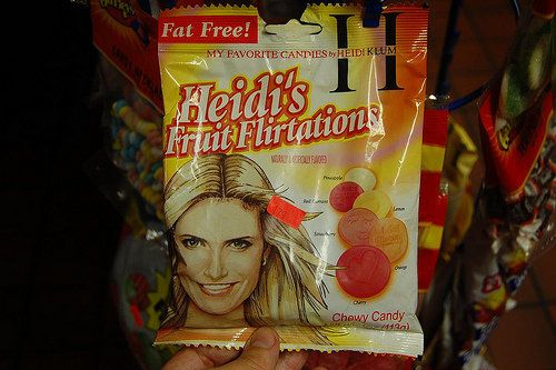 "How many bags of Heidi Klum's candy do you need to eat before fitting into a Victoria Secret ""Angels"" costume? (via <a href="""