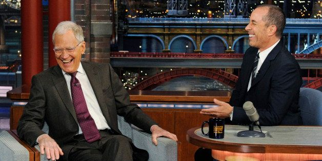In this photo provided by CBS, host David Letterman, left, sits in the guest's chair as comedian Jerry Seinfield sits at Le