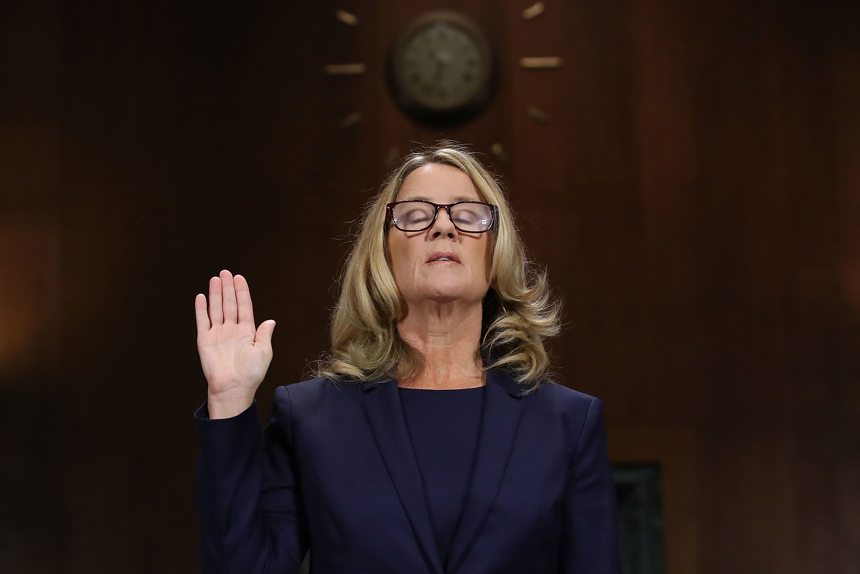 WASHINGTON, DC - SEPTEMBER 27:  Christine Blasey Ford is sworn in before testifying the Senate Judiciary Committee in the Dirksen Senate Office Building on Capitol Hill September 27, 2018 in Washington, DC. A professor at Palo Alto University and a research psychologist at the Stanford University School of Medicine, Ford has accused Supreme Court nominee Judge Brett Kavanaugh of sexually assaulting her during a party in 1982 when they were high school students in suburban Maryland. In prepared remarks, Ford said, ÒI donÕt have all the answers, and I donÕt remember as much as I would like to. But the details about that night that bring me here today are ones I will never forget. They have been seared into my memory and have haunted me episodically as an adult.Ó  (Photo by Win McNamee/Getty Images)
