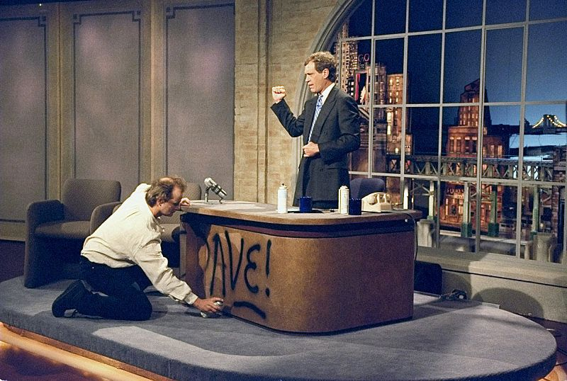 "Bill Murray spray paints Dave's desk on the first taping of ""The Late Show with David Letterman"" August 30, 1993 on the CBS T"