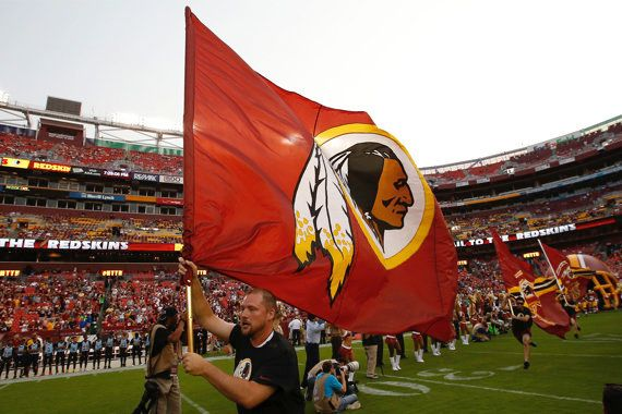 """<strong>EXAMPLE: Washington Redskins Flag</strong>  A flag bearing the Redskins logo gets a 9/10, or """"Unforgivably Racist."""" T"""