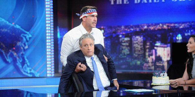 NEW YORK, NY - AUGUST 06:  Host Jon Stewart, Rob Riggle and Olivia Munn appear on 'The Daily Show with Jon Stewart' #JonVoyag