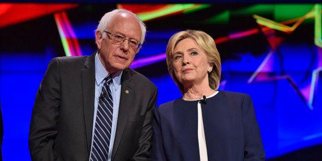 Democratic presidential candidates  Sen. Bernie Sanders, of Vermont, left, and Hillary Rodham Clinton talk before the CNN Dem