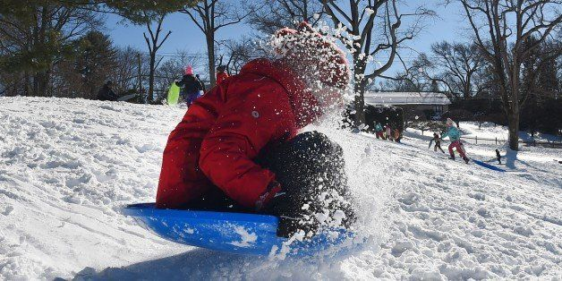 A child goes sledding down a hill in Greenwich, Connecticut January 24, 2016.