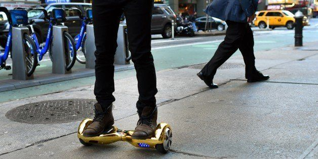 Whizboard Store manager 'Mor Loud'  demonstrates the Hoverboard on Broadway in Times Square in New York on December 15, 2015.