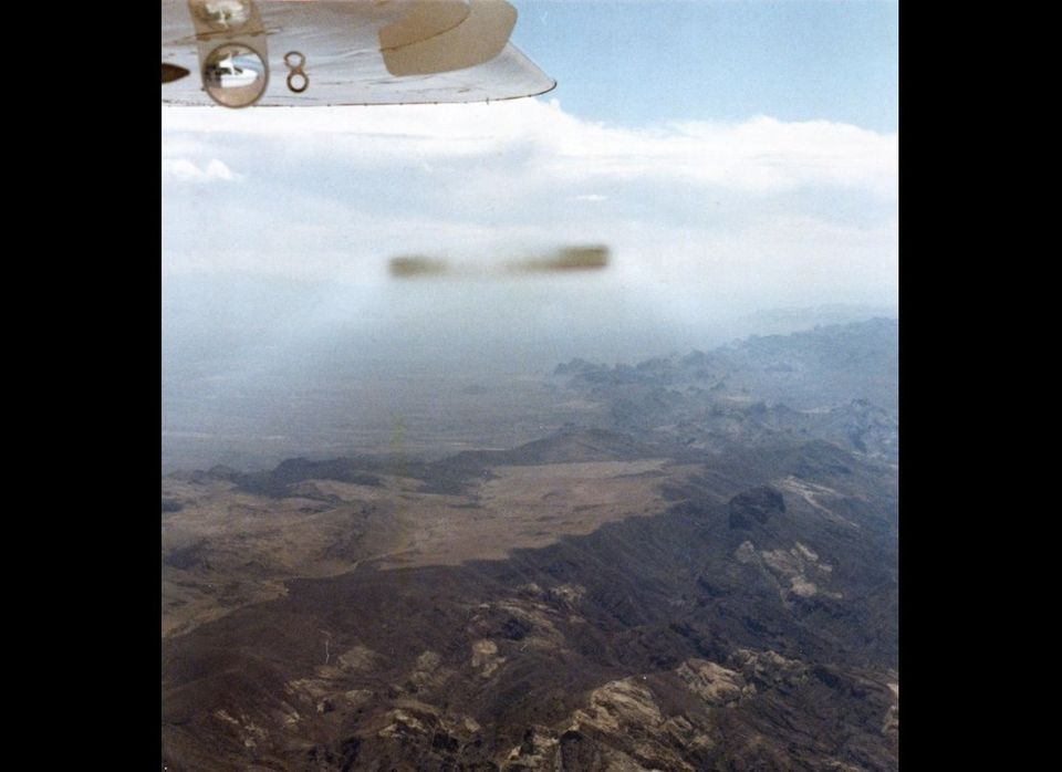This cigar-shaped UFO was photographed by general aviation pilot David Hastings as he piloted a Cessna Skymaster plane over t