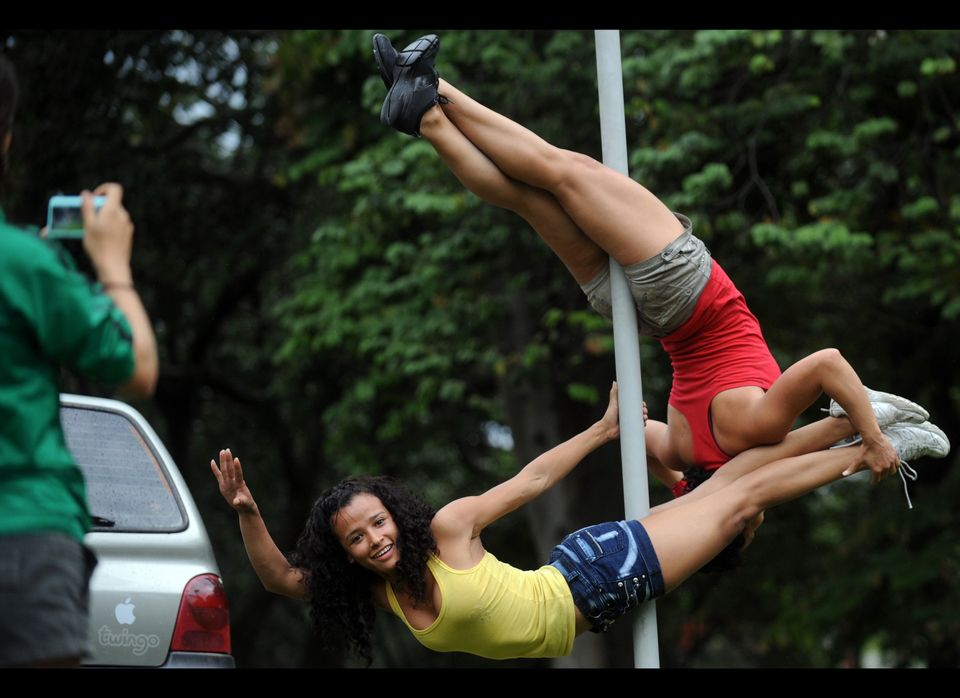 Some of Colombia's most accomplished pole dancers want to take the sport out of the strip clubs and into the streets by swing