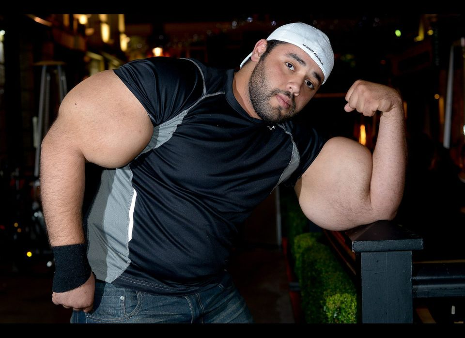 Moustafa Ismail, 24, who has the largest biceps in the World photographed in London as he arrives to promote the news Guinnes