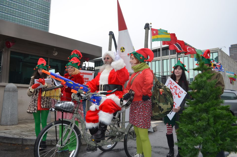 Well-known prankster Joey Skaggs, dressed as Santa Claus, arrives at the United Nations on a tricycle carrying a phony missil