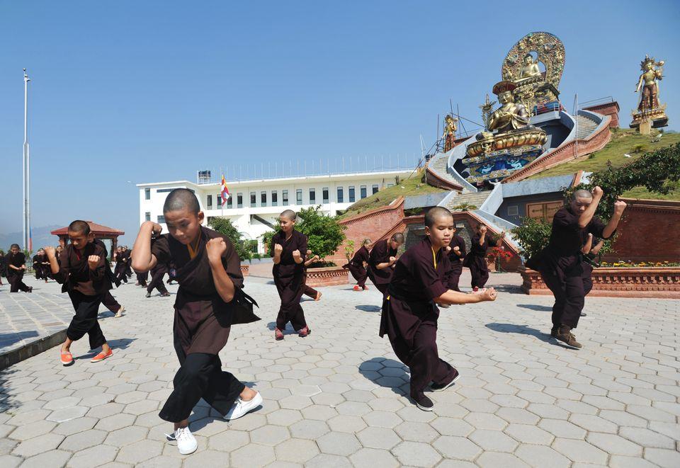 Buddhist nuns practise Kung-fu at the Amitabha Drukpa Nunnery on the outskirts of Kathmandu on April 26, 2012. Buddhist nuns