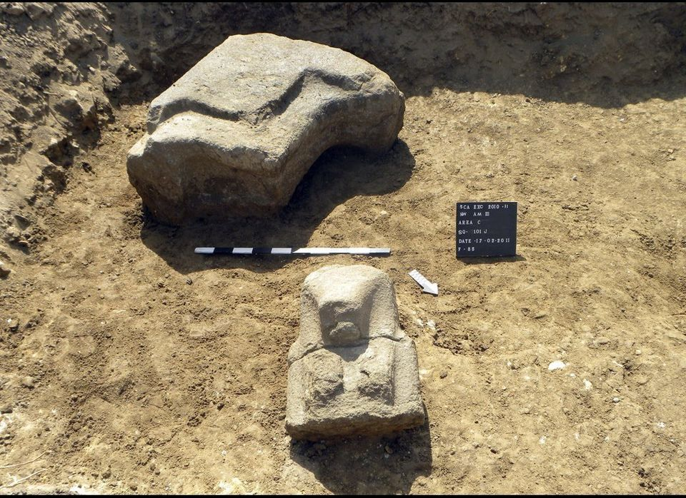 In this image made available by the Egyptian Supreme Council of Antiquities on April 26, 2011, parts of a statue are seen dur