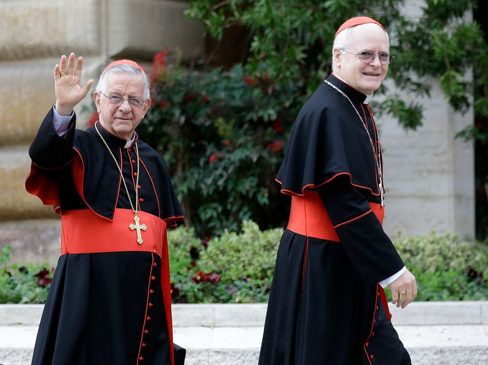 Cardinal Odilo Pedro Scherer, right, and compatriot Cardinal Geraldo Majella Agnelo wore matching outfits. They're practicall