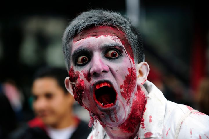 A man dressed up as a zombie takes part in a 'Zombie Walk' at the Revolution Monument in Mexico City on November 3, 2012. Acc