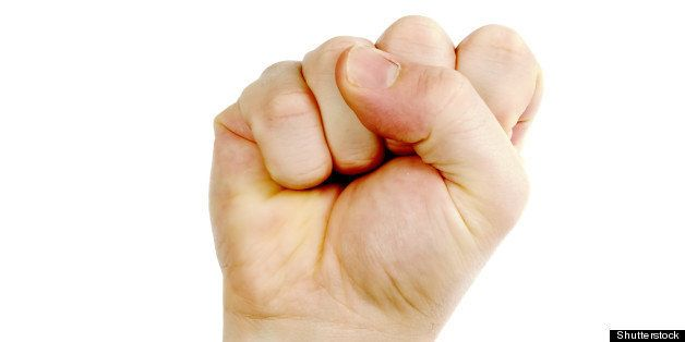 a male fist in the air isolated ...