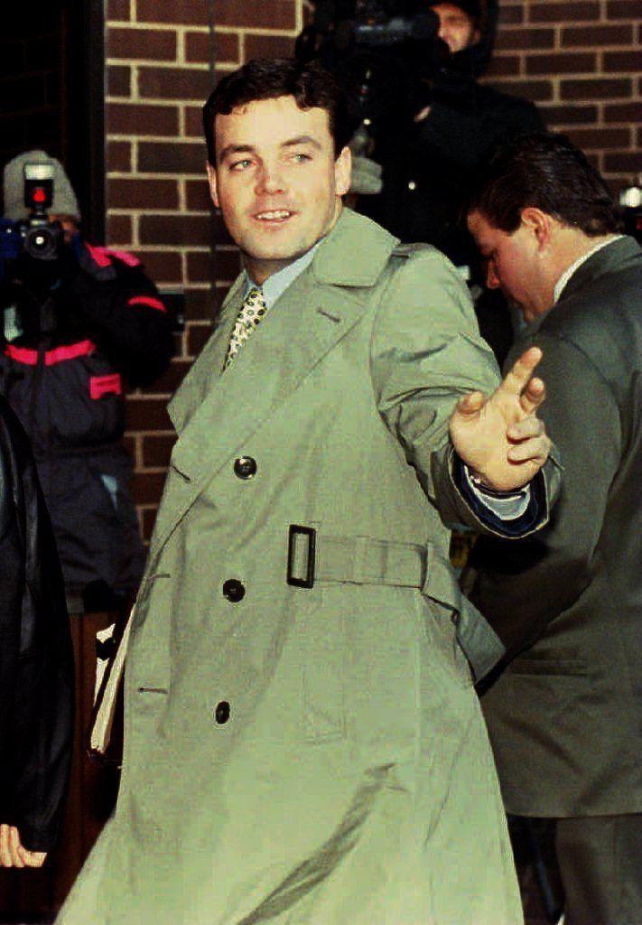MANASSAS, VA - JANUARY 18:  John Wayne Bobbitt points toward photographers as he arrives at the Prince William County Courtho
