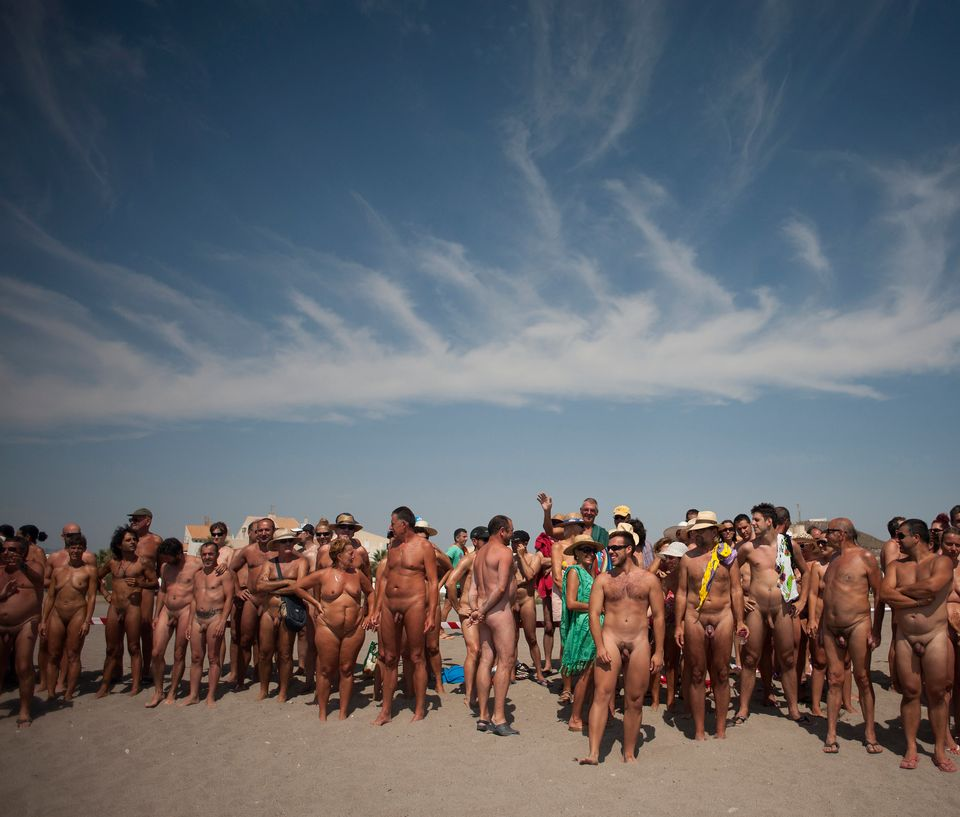 Some of several hundreds nudists stand on the beach as they break the world record of collective bathing of naked people with