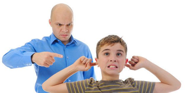 strict father punishes his son. ...