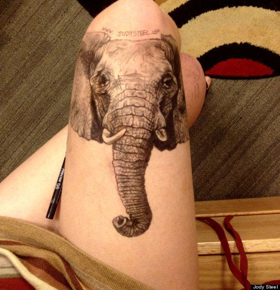 She's not a tattoo artist, but she's thinking about which of her leg drawings she'll make permanent. This elephant is in the
