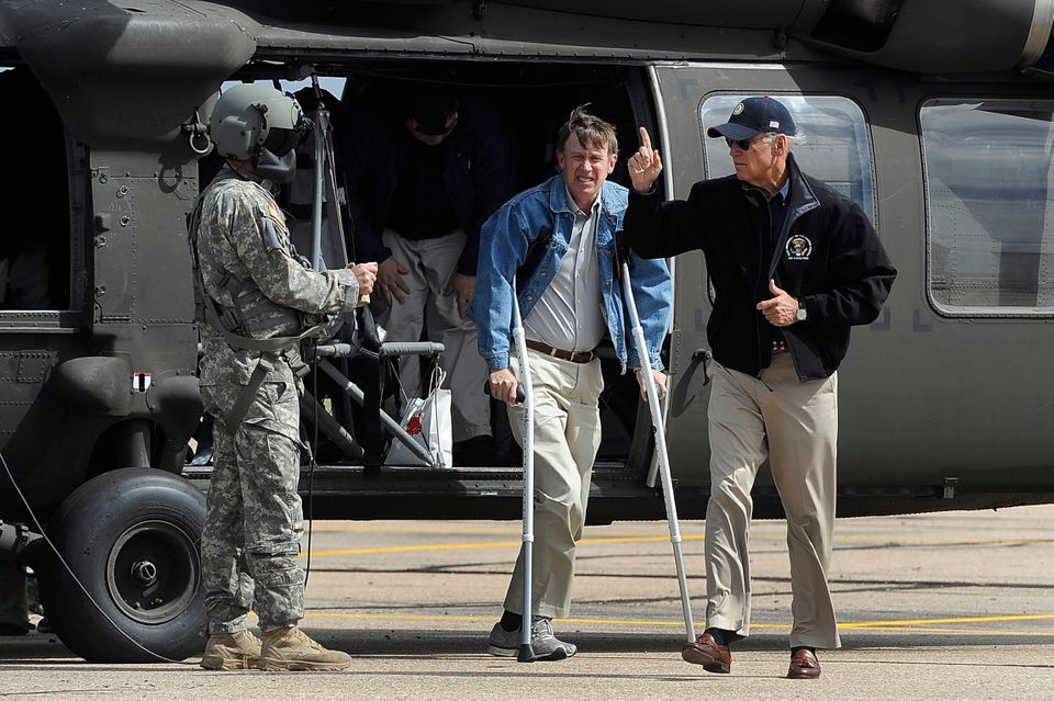 Vice President Joe Biden, right, arrives with Gov. John Hickenlooper, center, in Greeley, Colo. after surveying the flood dam