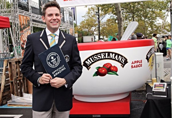 Guinness World Records adjudicator Michael Empric officiates and authorizes the event.
