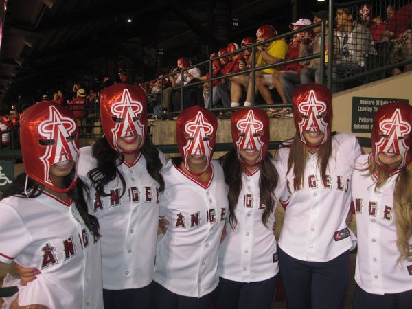The world record for Most People Wearing Costume Masks is 27,080. It was set May 10, 2011, at Angel Stadium in Anaheim, Calif