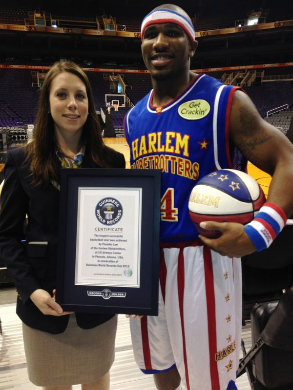 Harlem Globetrotters star Thunder Law threw a basketball 104 feet, 7 inches to break the record for the Longest Basketball Sh