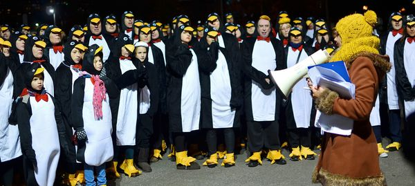About 325 British citizens flew into the record books when they all dressed as penguins (which don't actually fly).