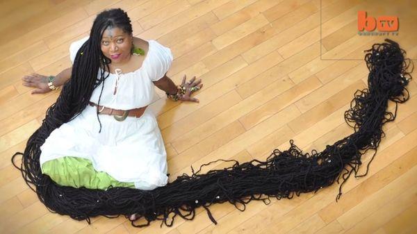 "Asha Mandela owns the world record for the longest dreadlocks, <a href=""https://www.huffpost.com/entry/asha-mandala-dreadlock"