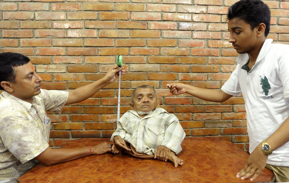 Nepali villager Master Nau, 73, stands 16 inches tall and claims to be the shortest man in the Guinness World Records' immova