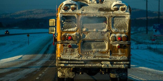 A school bus makes it's way during morning's freezing temperatures reaching bellow 25 degrees Celsius on Trans Canada  Highwa