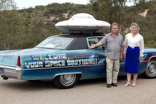 Unarius students William Proctor and Lani Calvert stand with with the Space Cadillac, which they drive around San Diego to pr