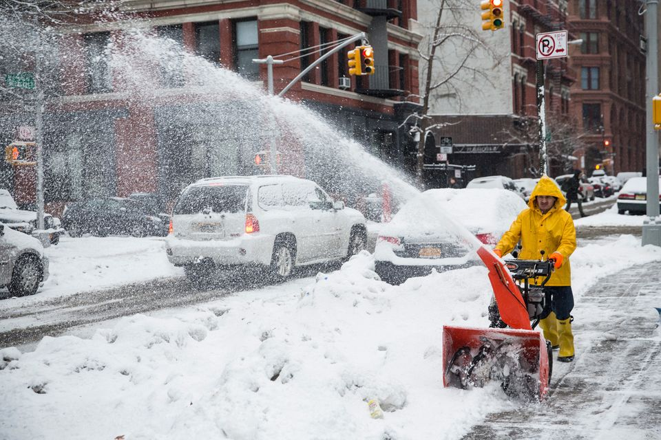 NEW YORK, NY - FEBRUARY 18:  A man uses a snow blower to clear a sidewalk on February 18, 2014 in New York City. The city was