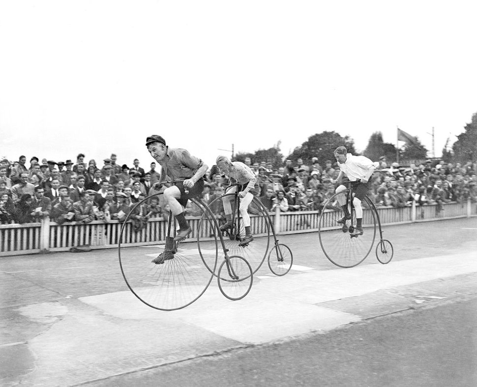 Competitors all out in the old Penny-farthing race at the Herne Hill track cycle meeting.  (Photo by Planet News Archive/SSPL