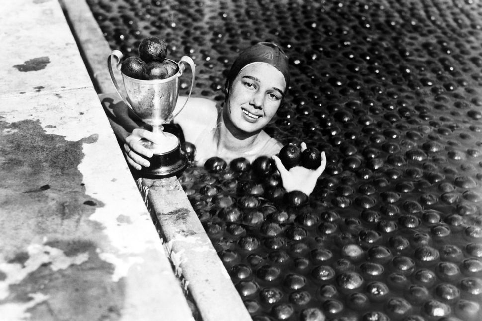Jessie Darnley swims way to title of 'Miss Anaheim' in pool filled with 3 tons of oranges on September 23, 1932 in Anaheim, C