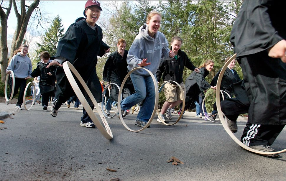 Over 200 seniors of Wellesley College's class of 2003 participate in the 107th annual hoop rolling contest on the grounds of