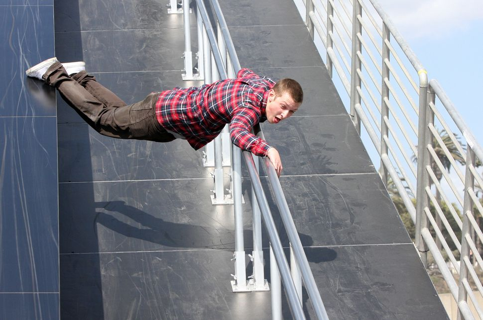 A Powersliding competitor shows off his freestyle sliding skills at Levi's 3rd annual Powersliding Championships on April 15,