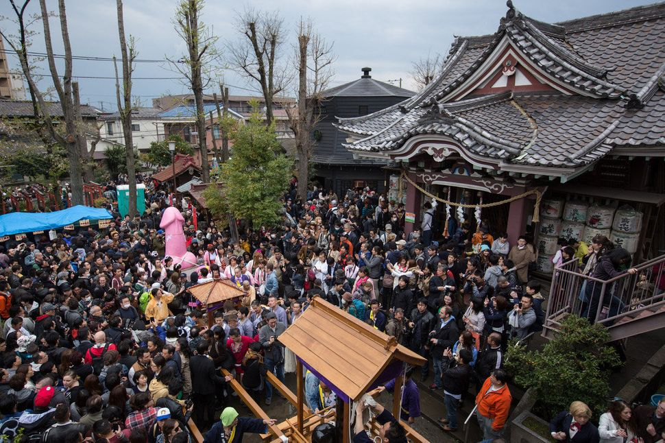 People gathered at the Wakamiya Hachimangu shrine during Kanamara Matsuri.
