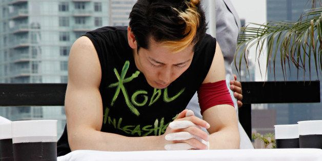 NEW YORK, NY - JULY 04:  Competitive eater Takeru Kobayashi prepares to challenge 2011 Nathan's Famous Hot Dog Eating Competi