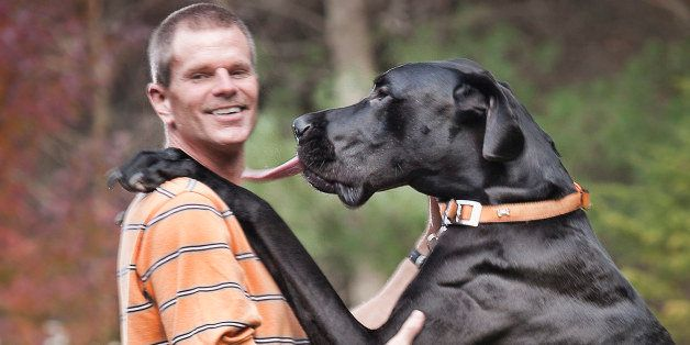 In an undated photo provided by Guinness World Records 2013 Book, Kevin Doorlag stands with his dog Zeus in Otsego, Mich. The