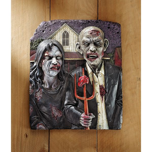 "This zombiefied version of the <a href=""http://www.wayfair.com/Design-Toscano-Zombie-Gothic-Wall-Sculpture-CL6268-TXG5159.htm"