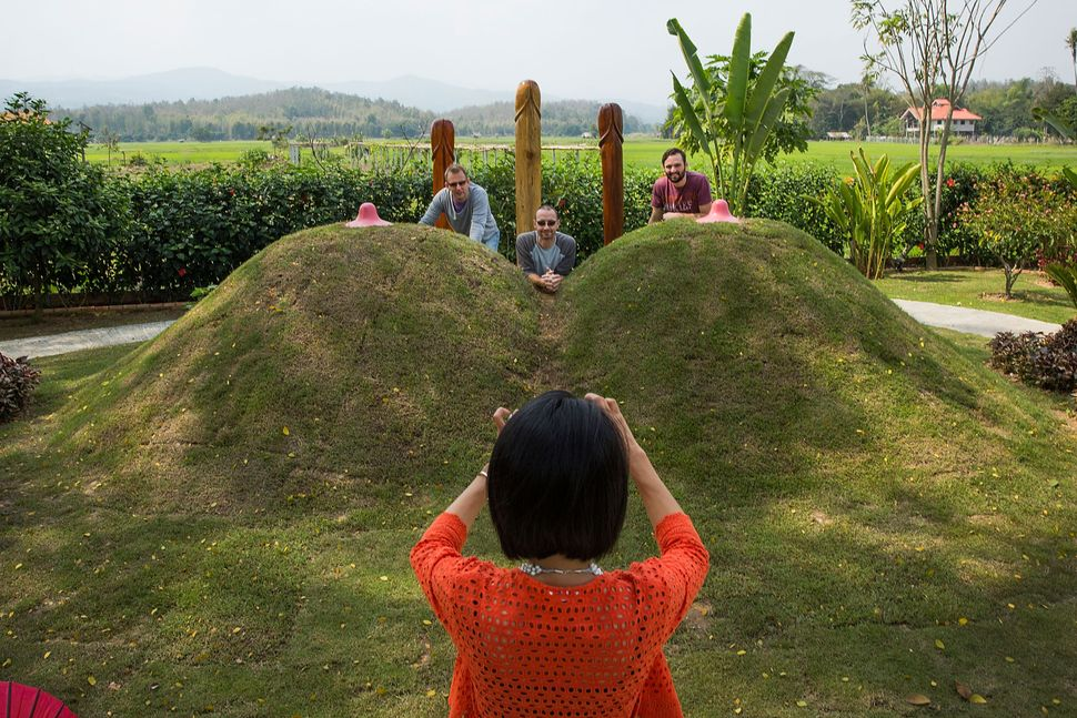Visitors have their pictures taken at the Erotic Garden and Teahouse on February 7, 2015 in Mae Rim, Thailand.