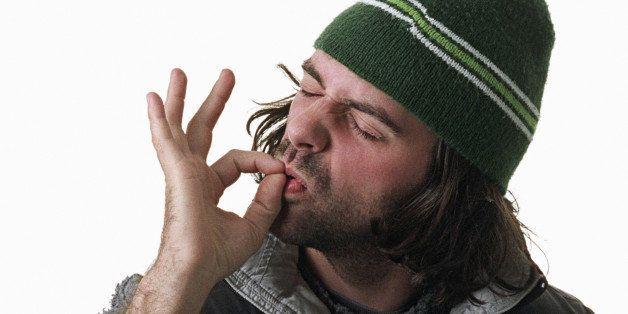 Man pretending to smoke marijuana