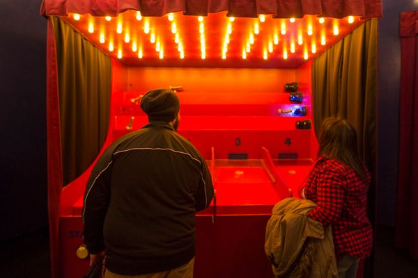 "An erotic themed carnival game at the ""Museum of Sex"" in New York City."
