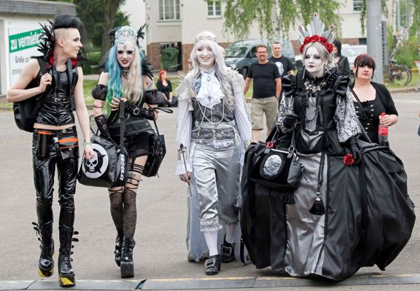 Participants of the Wave Gothic Festival arrive the festival area in costumes in Leipzig, Germany, on Saturday. (AP Photo/Jen