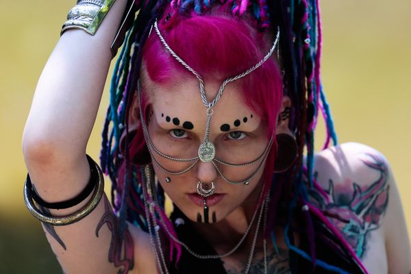 "A participant in the Wave Gothic Festival poses at the ""Victorian Picnic"" in a park in Leipzig, central Germany, on June 6, 2"